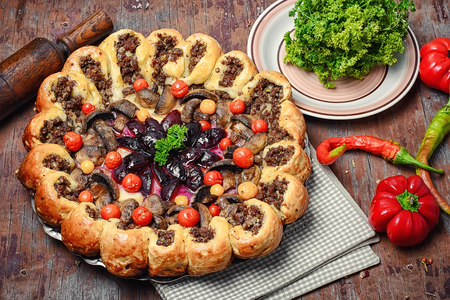 Traditional pie stuffed with meat decorated vegetables Stock Photo