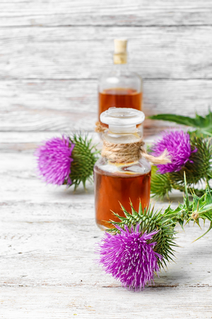 Glass vial with therapeutic drug of the flowering milk Thistle Stock Photo