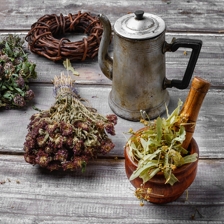 Vintage metal teapot with the infusion of medicinal herbs Stock Photo