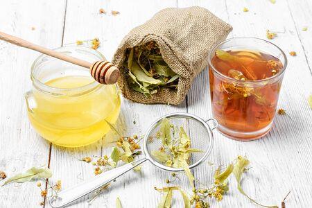 Glass mug with medicinal flower linden tea