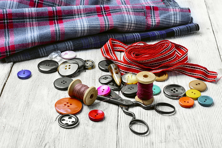 needle laces: Accessories tailor of thread,set buttons and fabric Stock Photo