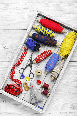 needle laces: Wooden box with sewing thread,buttons and lace Stock Photo
