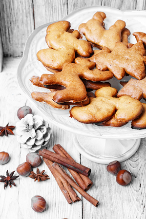 baking christmas cookies: Home baking Christmas cookies in bright white vase Stock Photo