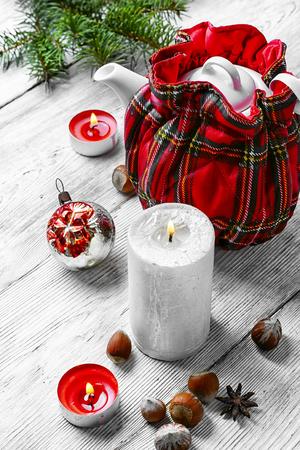 warmer: Kettle in stylish tea warmer Christmas background.
