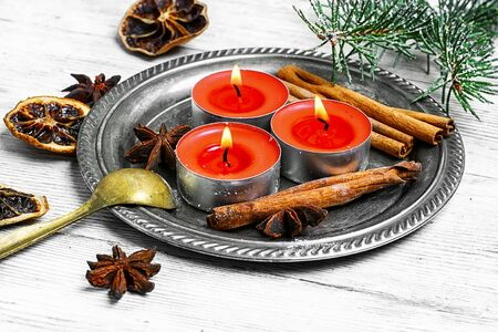 christmas perfume: Christmas candle with cinnamon,star anise and fir branch