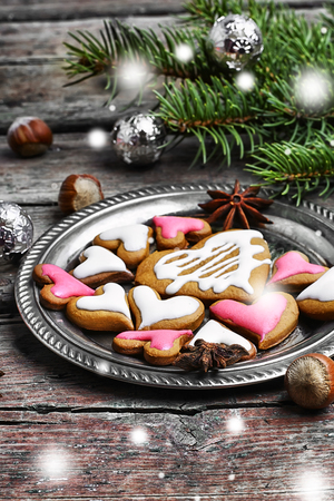 loved: Loved Christmas cookies in shape of hearts on saucer Stock Photo