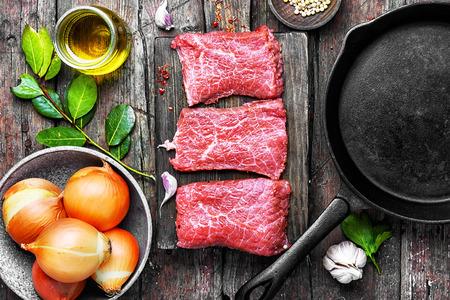 Raw steaks of veal,prepared for roasting in pan