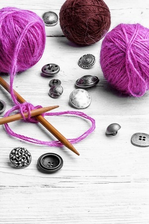 Kit knitting wool and knitting needles and buttons Stock Photo