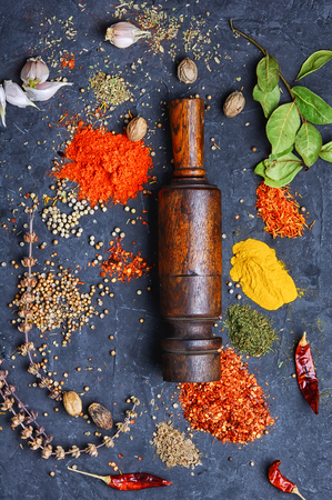 set spicy spices in spoons on slate background Stock Photo