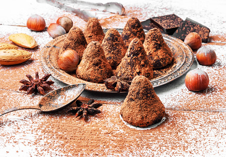 Chocolate truffles candies with cocoa powder and nuts