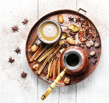 cezve and cup of coffee in copper tray with oriental spices. Stock Photo