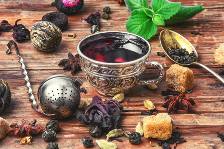Cup of tea,dry tea leaves of different varieties and spices Stock Photo