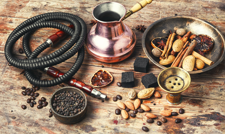 aroma Arab hookah with coffee in vintage style.