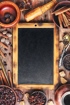 coffee background ,cinnamon and nuts on rustic background.Copy space
