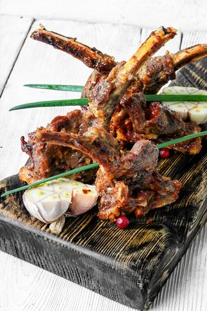 fragrant roast of lamb chops on board.