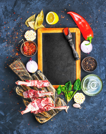 Raw meat on the rib of lamb in hot spices Stock Photo