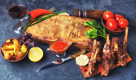Menu of roast rib of sheep, potatoes, gravy and vegetables. Stock Photo