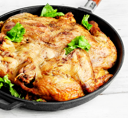 chicken cooked in pan with spices according to the Georgian recipe