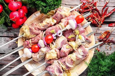 Raw pork meat on skewer,prepared for frying