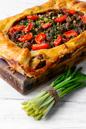 Delicious meat pie stuffed with mushrooms and tomato Stock Photo