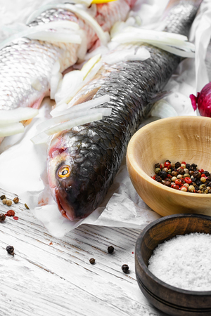 Fishing with two carcasses of large fish for cooking with spices.