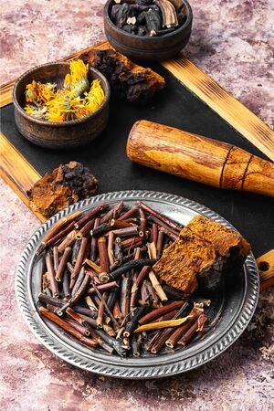 Medicinal herbs and root, comfrey, inonotus obliquus and calendula Stock Photo