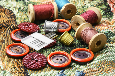 Set of different buttons from clothing,thread and sewing supplies