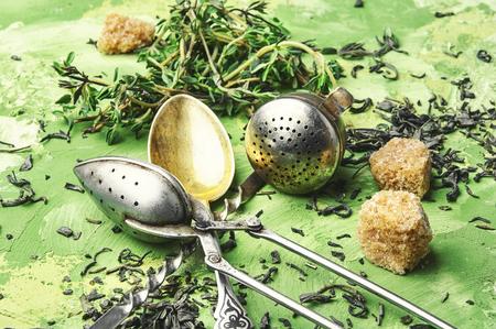 Dry tea leaf and fresh thyme for tea.