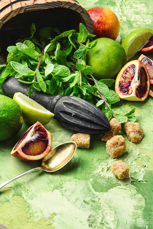ingredients for summer refreshing drink of lime,mint and orange