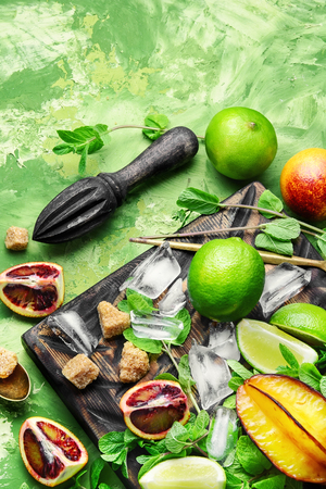 ingredients for summer refreshing drink of lime, mint and orange