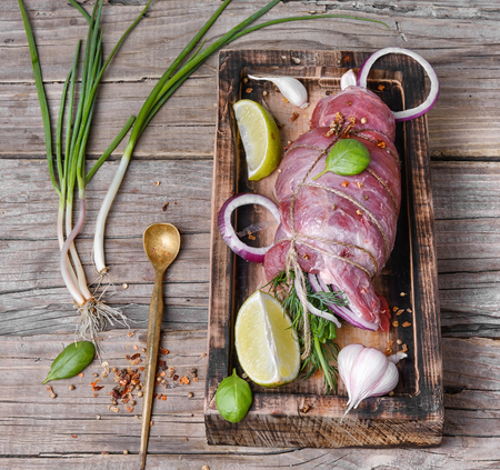 meatloaf: Raw meat.Raw beef with spices on the kitchen Board Stock Photo