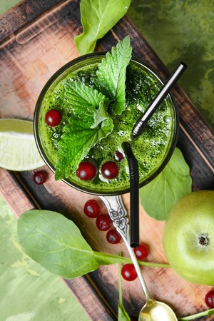 Freshly spinach smoothie.Blended green smoothie drink with spinach and apple
