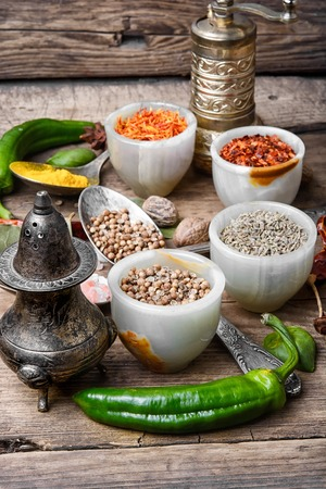 peppery: Variety of spices and seasonings on kitchen table