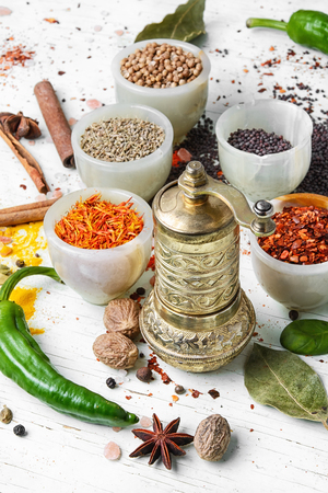 Variety of spices and seasonings on kitchen table