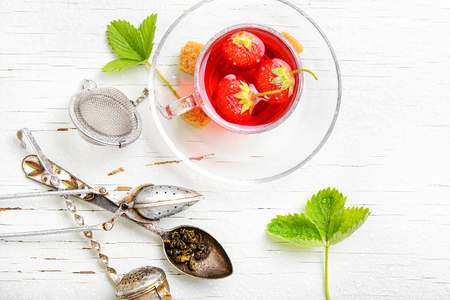 Summer fruit tea with strawberries on light background Stock Photo