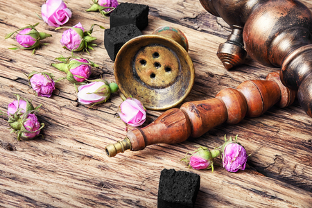 Smoking east hooka with the tobacco of aroma of tea-rose Stock Photo