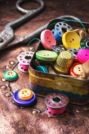 sewing box: Old-fashioned metal box with buttons and threads
