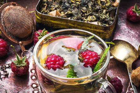 Berry tea with raspberries Stock Photo