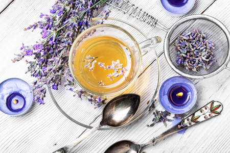 Fragrant herbal tea with flowering lavender sprigs