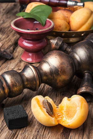 Smoking hookah with tobacco with apricot flavor Stock Photo