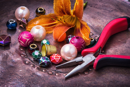 Making of handmade jewellery from colorful beads