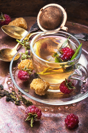 Autumn warming and anti-cold tea with raspberries Stock Photo
