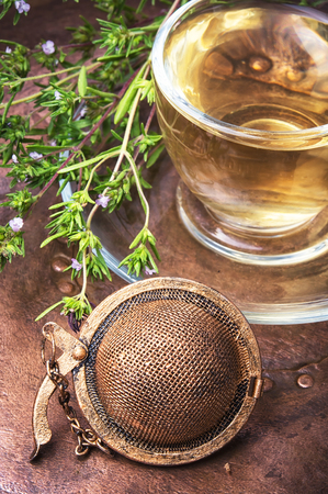 Herbal tea with Oregano in glass cup in a rustic style Stock Photo
