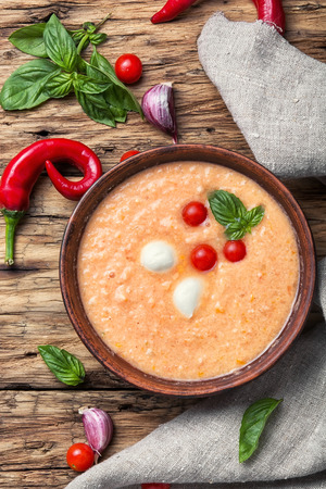 gazpacho: Gazpacho soup with basil on the old wooden background