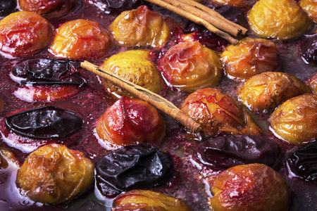 autumn dessert with plums baked in sweet caramel Stock Photo