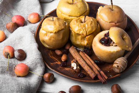 Baked autumn apples stuffed nuts and berries Stock Photo