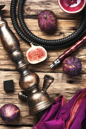 Exotic smoked shisha with tobacco with a taste of fig fruit