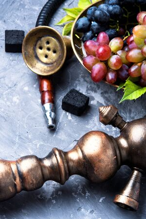 Exotic smoked shisha with tobacco with a taste of grapes Stock Photo