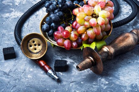 smoked shisha with tobacco with taste of grapes