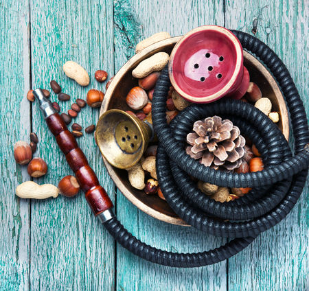 Details of a smoking shisha with tobacco flavor of hazelnut and almonds.Hookah background